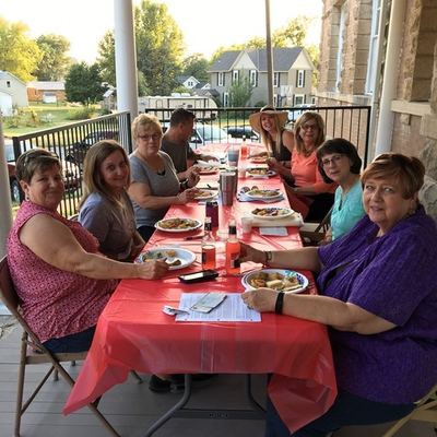 Board anniversary meeting on the porch - September 2017.